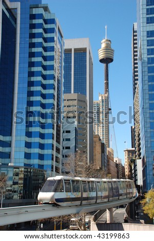 Sydney mono rail downtown with Sydney Tower and skyscrapers in the background - stock photo