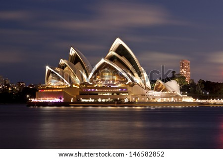 SYDNEY - NOV 7: The Sydney Opera House, viewed from Circular Quay in Sydney, Australia on November 7, 2011. It was designed by Danish architect Jorn Utzon.  - stock photo