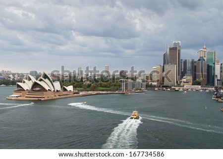 SYDNEY - NOV 21: View of Sydney and the Harbor on November 24, 2013 in Sydney, Australia. Over 10 millions tourists visit Sydney every year, making Sydney one of the world's top tourist destinations. - stock photo