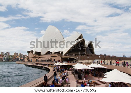 SYDNEY - NOVEMBER 23: Sydney Opera House view on November 23, 2013 in Sydney, Australia. The Landmark is a famous arts center. It was designed by Danish architect Jorn Utzon, finally opening in 1973. - stock photo