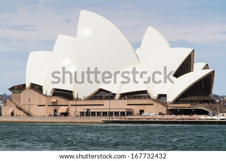 SYDNEY - NOVEMBER 23: Sydney Opera House view on November 23, 2013 in Sydney, Australia. The Landmark is a famous arts center. It was designed by Danish architect Jorn Utzon, finally opening in 1973.