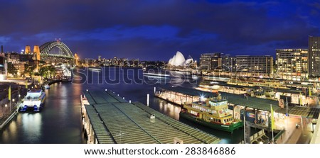 Sydney, NSW, AUstralia - April 7, 2012: City's iconic place with famous Opera House, Harbour Bridge and Circular QUay at sunset