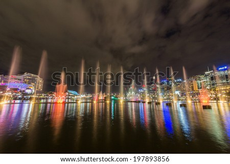 SYDNEY, NSW, AUSTRALIA - MAY 29, 2014: Sydney's CBD Darling harbor night scape and reflection during the annual Vivid Sydney festival.  - stock photo