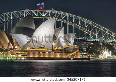 SYDNEY - OCTOBER 12, 2015: The Iconic Sydney Opera House is a multi-venue performing arts centre also containing bars and outdoor restaurants. - stock photo