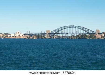 sydney opera house and harbor bridge on the harbour - stock photo