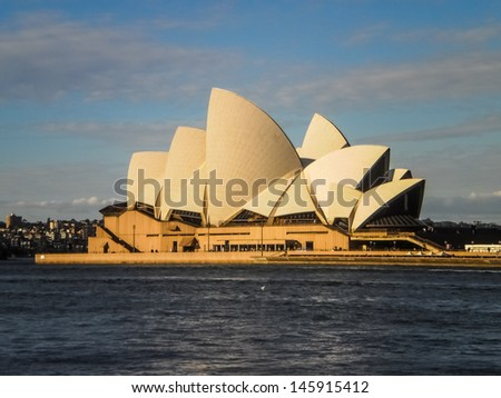 SYDNEY -SEPTEMBER 22 :Sydney opera house view from the Sydney harbour on  September 22,2011 .It was designed by Danish architect Jorn Utzon . - stock photo