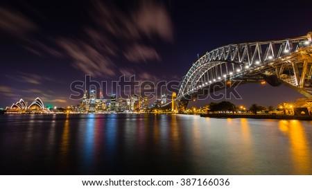 Sydney Skyline and Harbor Bridge in the Night from Jeffrey Strret Wharf, Kirribilli, Sydney, NSW, Australia - stock photo
