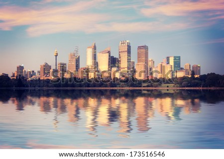 Sydney skyline from Mrs Macquarie's point at sunrise, with an Instagram style filter. - stock photo