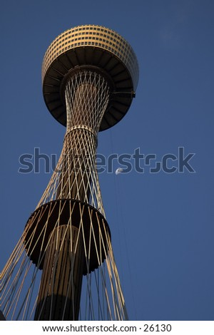 Sydney Tower in Australia, with the moon in the background - stock photo