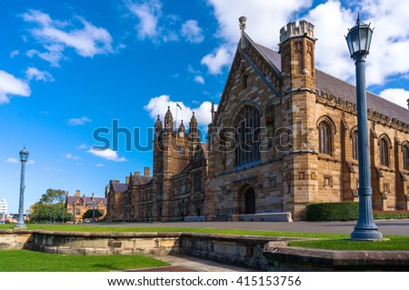 Sydney Uni building facade. University of Sydney against deep blue sky with white clouds, daytime photo - stock photo