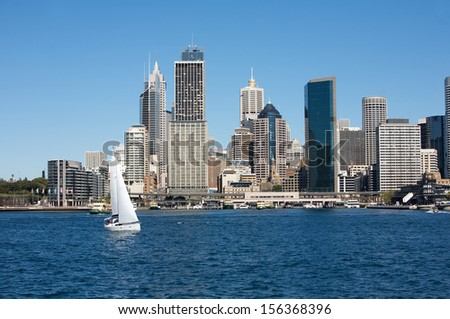Sydney view with city skyline in the background and boat in the water, Australia