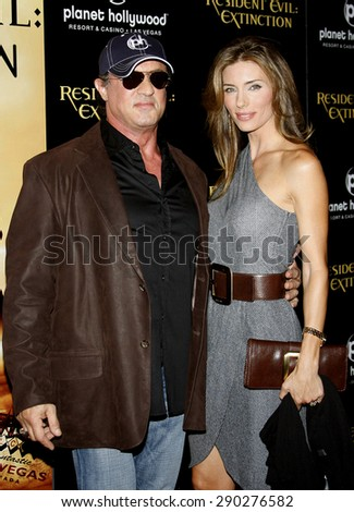 "Sylvester Stallone and Jennifer Flavin attend the World Premiere of ""Resident Evil: Extinction"" held at the Planet Hollywood Resort & Casino in Las Vegas, Nevada, United States on September 20, 2007.  - stock photo"