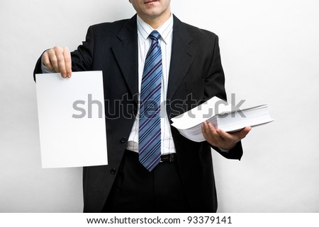Symbilic picture. Suited man holding stack of documents. - stock photo