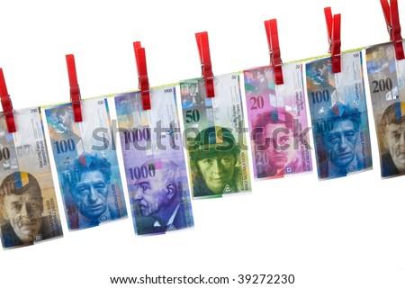 Symbol for money laundering, using Swiss francs on clothesline - stock photo