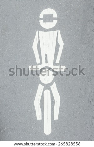 Symbol motorcycle road sign painted on a white pavement - stock photo