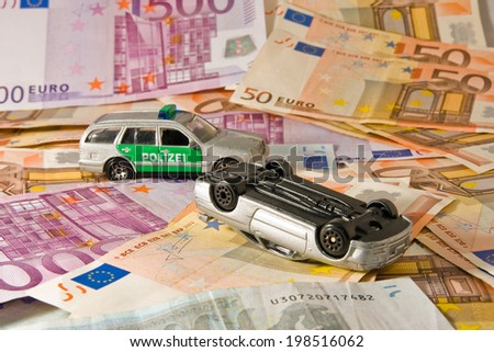 Symbol of assurance and possible costs in case of a car accident - stock photo