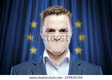 Symbol of censorship and freedom of speech: a young man without a mouth on a background of the flag of Europe (EU) - stock photo
