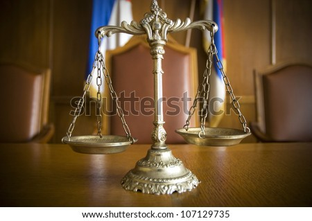 Symbol of law and justice in the empty courtroom, law and justice concept