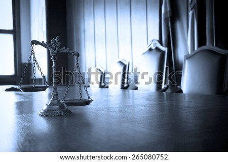 Symbol of law and justice in the empty courtroom, law and justice concept, BLUE TONE - stock photo