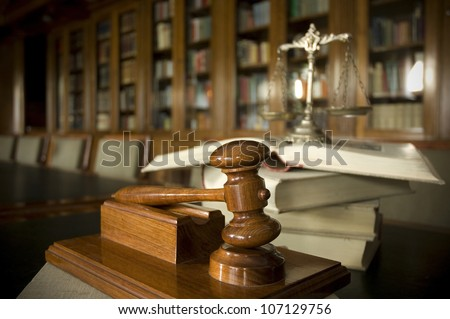 Symbol of law and justice in the library, law and justice concept, focus on the gavel - stock photo