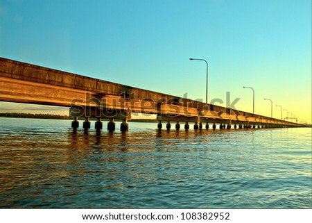 Symbol of modern man and environment as houton travels over ocean Brisbane with copy space - stock photo