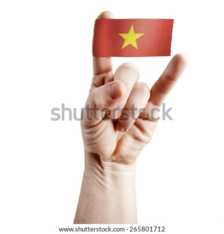 Symbol of national coolness: rock hand - symbol of the horns with the flag of Vietnam - stock photo