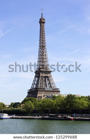 symbol of Paris - the Eiffel tower, view from river