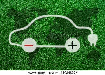 Symbol of the electric cars on the grass. - stock photo