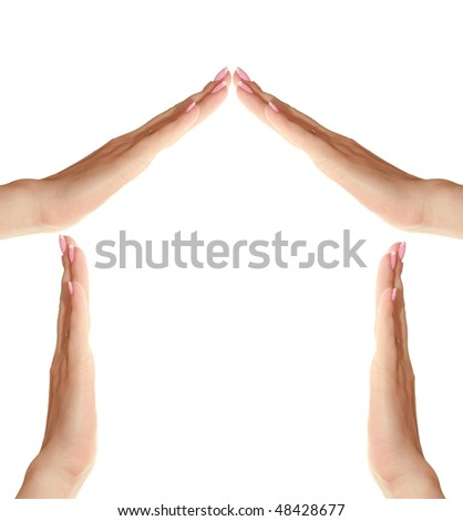 symbol of the house of women's hands - stock photo
