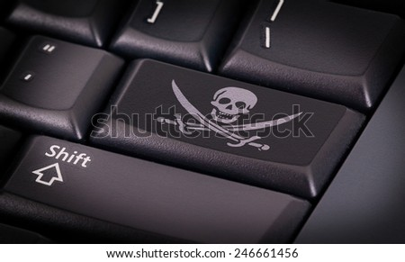 Symbol on button keyboard, pirate - concept of criminality - stock photo