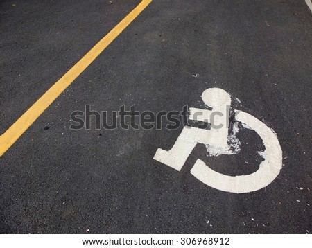 Symbol parking, street for disabled on the floor. - stock photo