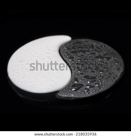 symbol Yin-Yang of stone texture, the sign of the two elements with few on water black background - stock photo