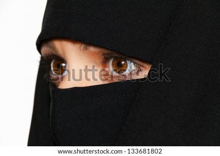 symbolfoto islam. muslim women wearing the burqa is veiled. - stock photo