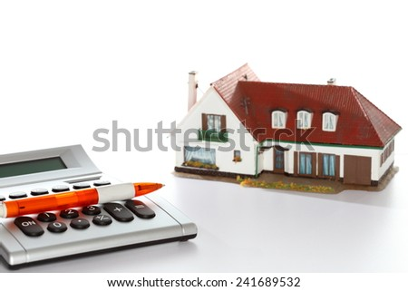 symbolic calculating costs of a house with white background - stock photo