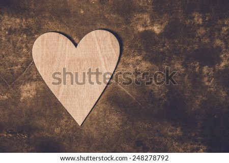 Symbolic heart lies on a background, with place for your text - stock photo