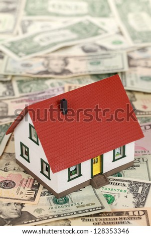 Symbolic picture for financing a real estate with a house on Dollar notes - stock photo