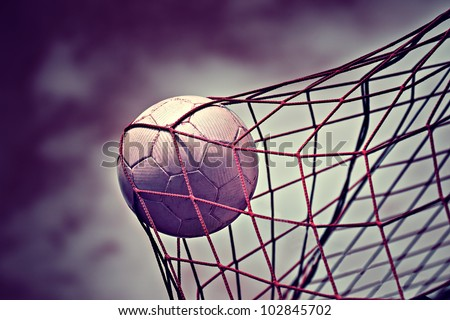 symbolic picture for goal with a soccer ball in net - stock photo