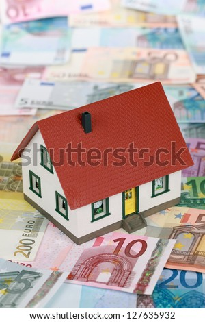Symbolic picture for home financing with a building on Euro notes - stock photo