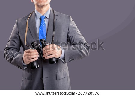 symbolic picture of a businessman with a binoculars - stock photo