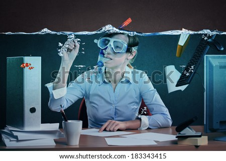 symbolic picture of a stressed female office worker and for stress at work