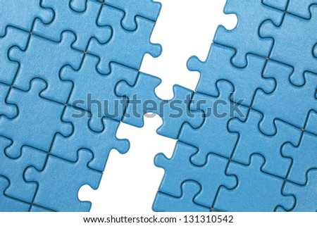 Symbolic picture showing the connection between two parts with a puzzle