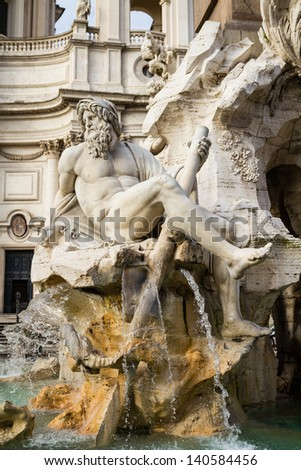 Symbolic river Ganges figure at the Fontana dei Quattro Fiumi in the centre of Piazza Navona, Rome. The fountain was designed by Bernini and unveiled in 1651. - stock photo