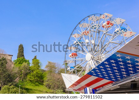 Symbols of the USA flag and Ferris wheel - stock photo