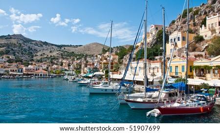 Symi Island in greece architecture harbor village - stock photo