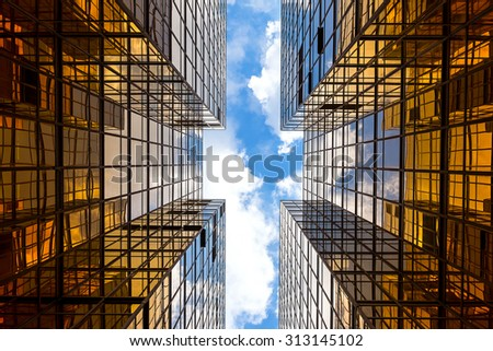 Symmetrical mirrored office buildings - stock photo
