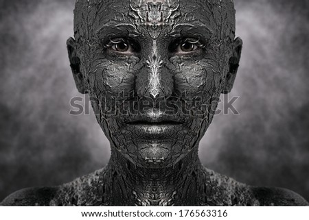 Symmetrical terrible face with cracked skin - stock photo