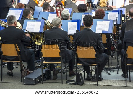 Symphonic Orchestra performs classical music concert - stock photo