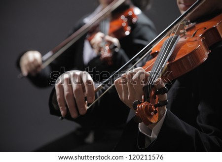 Symphony music, violinist at concert, hand close up - stock photo