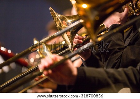 Symphony orchestra on stage, close-up. - stock photo
