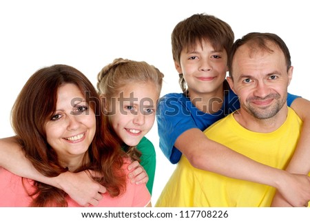 Sympothetic family of four in bright T-shirt on a white background - stock photo